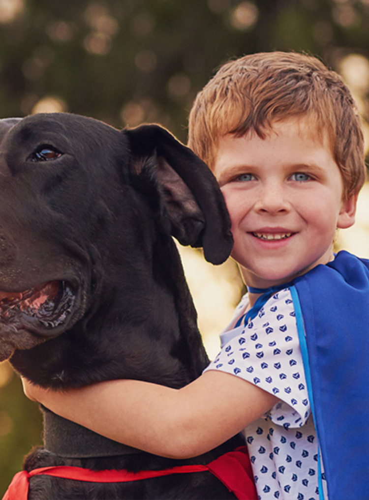E boy and dog